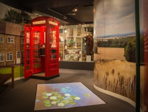 The interactive floor and red telephone kiosk, which are on the ground floor.